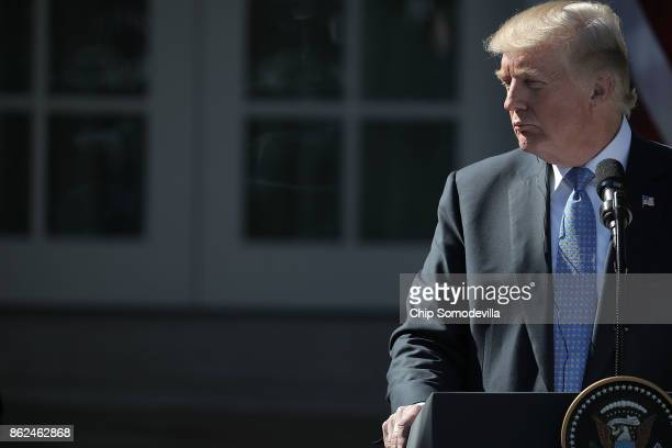 S President Donald Trump listens to Greek Prime Minister Alexis Tsipras during a joint press conference in the Rose Gard at the White House October...