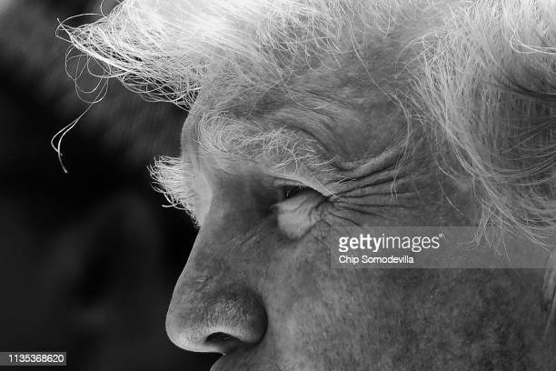 S President Donald Trump listens to reporters' questions during a joint news conference with Nigerian President Muhammadu Buhari in the Rose Garden...