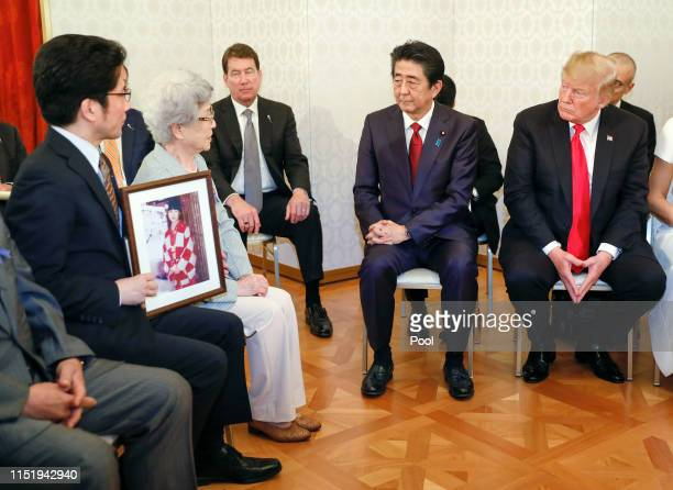 President Donald Trump listens to Sakie Yokota , mother of Megumi Yokota who was kidnapped by North Korean agents at the age of 13 in 1977, as he...
