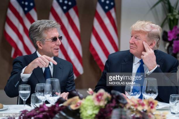 US President Donald Trump listens to SAP CEO Bill McDermott during a working dinner with European business leaders during the World Economic Forum...