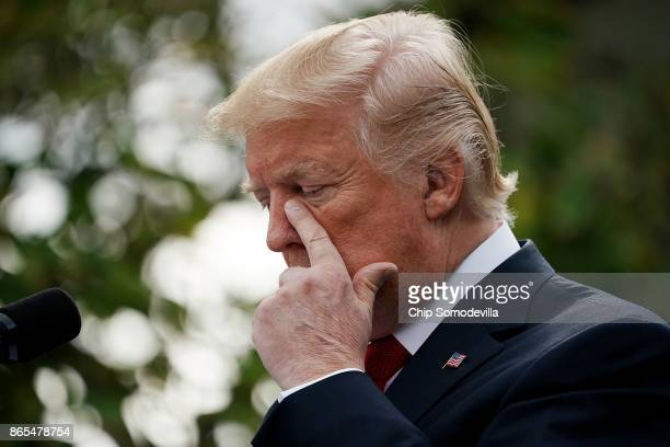 S President Donald Trump listens to Singapore Prime Minister Lee Hsien Loong as they deliver joint statements in the Rose Garden of the White House...