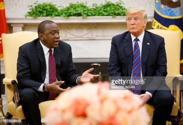 US President Donald Trump listens to the president of Kenya President Uhuru Kenyatta at the White House on August 27 2018 in WashingtonDC