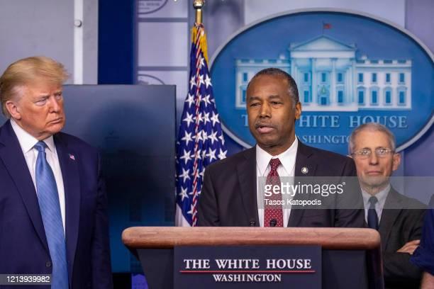 President Donald Trump listens to U.S. Housing and Urban Development Secretary Ben Carson speak during a briefing in the James Brady Press Briefing...