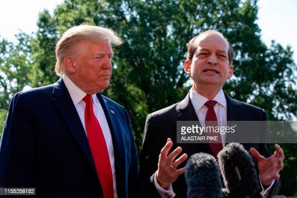 US President Donald Trump listens to US Labor Secretary Alexander Acosta as he speaks to the media early July 12 2019 at the White House in...