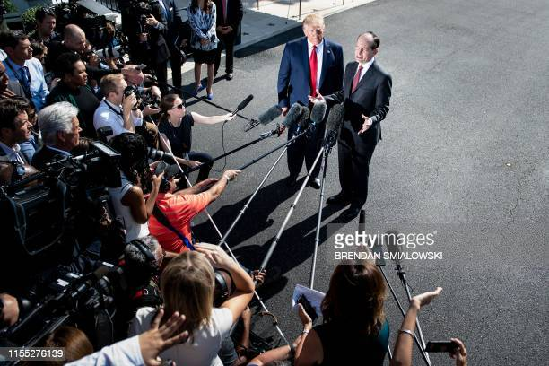US President Donald Trump listens to US Labor Secretary Alexander Acosta during a media address early July 12 2019 at the White House in Washington...