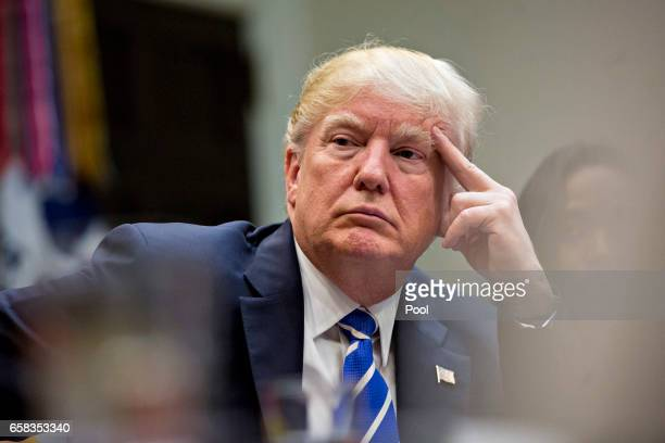 President Donald Trump listens while meeting with women small business owners in the Roosevelt Room of the White House on March 27, 2017 in...