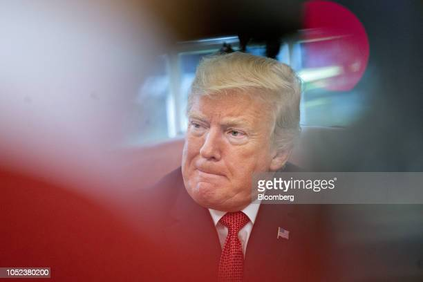 US President Donald Trump listens while meeting with workers in the Oval Office of the White House during a 'Cutting the Red Tape Unleashing Economic...