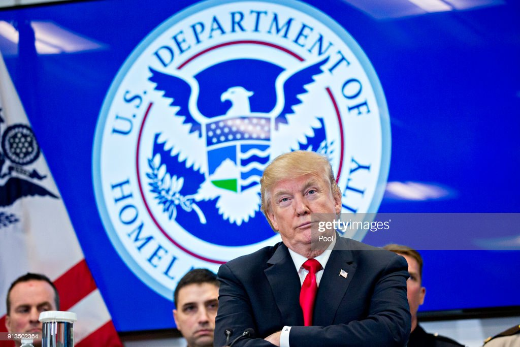 U.S. President Donald Trump listens while participating in a Customs and Border Protection (CBP) roundtable discussion after touring the CBP National Targeting Center February 2, 2018 in Sterling, Virginia. Trump is looking to ratchet up pressure on lawmakers to consider the immigration proposal he unveiled in Tuesday's State of the Union using the visit as an opportunity to again argue his proposal would bolster the country's borders.