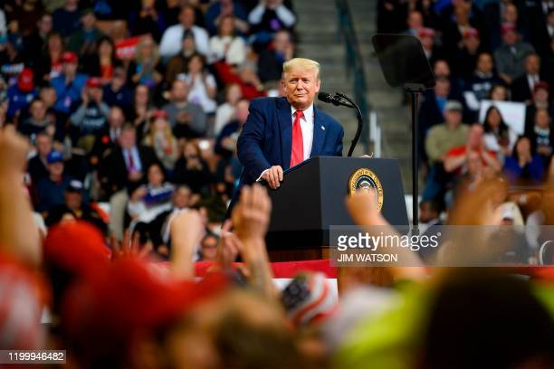 President Donald Trump looks at his supporters after reading words from Al Wilson's song The Snake during a rally in Manchester New Hampshire on...