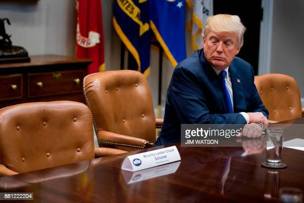 US President Donald Trump looks at the empty chair of Senate Minority Leader Chuck Schumer DNew York after Schumer cancelled their meeting at the...
