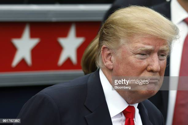 US President Donald Trump looks attends a picnic for military families in Washington DC US on Wednesday July 4 2018 Dozens of retired military and...