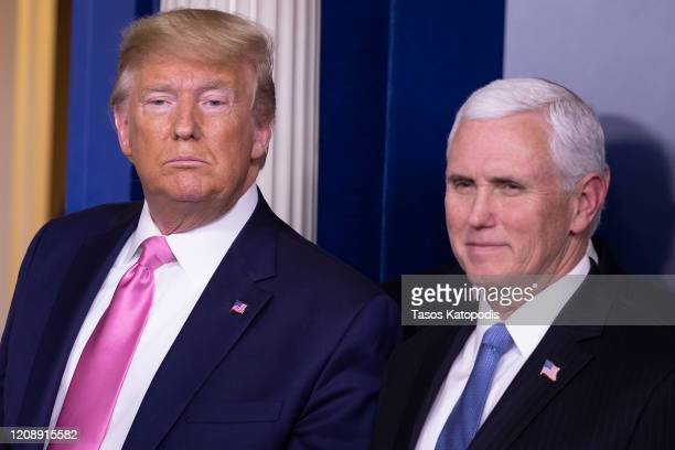 S President Donald Trump looks on after a news conference with Vice President Mike Pence in the Brady Press Briefing Room at the White House February...