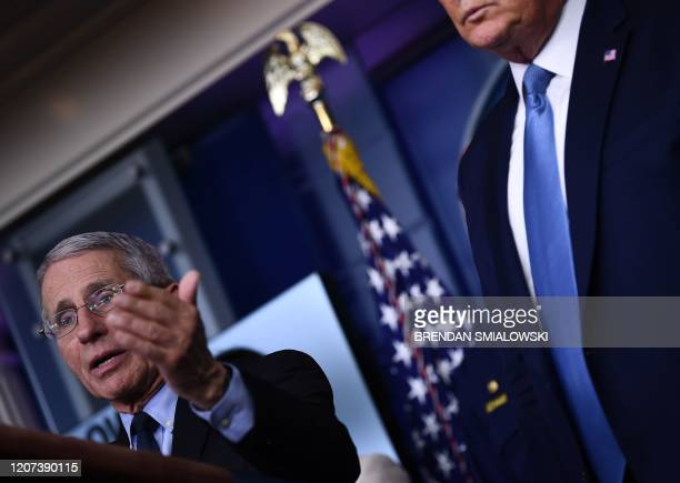 US President Donald Trump looks on as Director of the National Institute of Allergy and Infectious Diseases Dr Anthony Fauci speaks during a press...