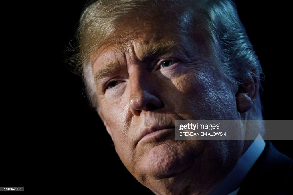 President Donald Trump looks on as he addresses a press conference on the second day of the North Atlantic Treaty Organization (NATO) summit in Brussels on July 12, 2018.