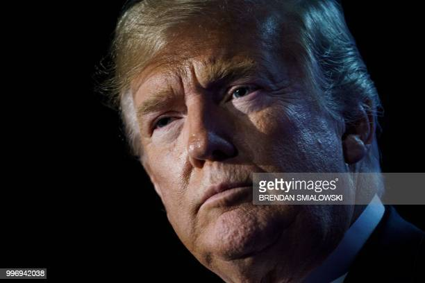 President Donald Trump looks on as he addresses a press conference on the second day of the North Atlantic Treaty Organization summit in Brussels on...
