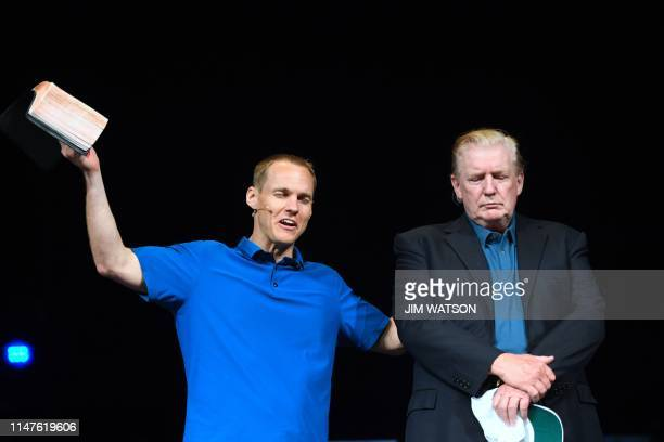 US President Donald Trump looks on as he visits McLean Bible Church in Vienna Virginia on June 2 to visit with Pastor David Platt and pray for the...