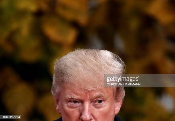 US President Donald Trump looks on as he visits the American Cemetery of Suresnes outside Paris on November 11 2018 as part of Veterans Day and the...