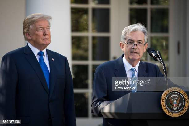 US President Donald Trump looks on as his nominee for the chairman of the Federal Reserve Jerome Powell speaks during a press event in the Rose...