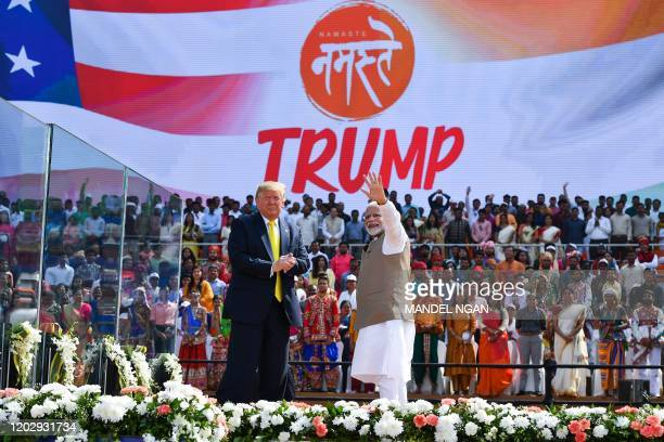 US President Donald Trump looks on as India's Prime Minister Narendra Modi waves during 'Namaste Trump' rally at Sardar Patel Stadium in Motera on...
