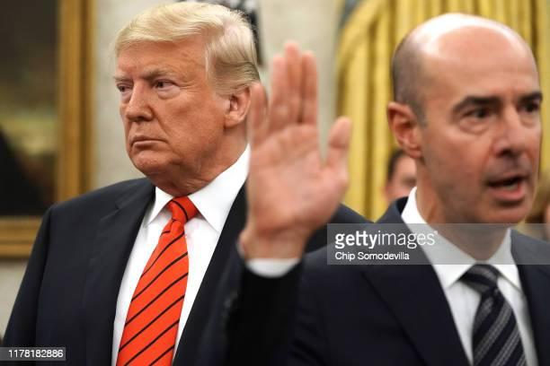 S President Donald Trump looks on as Labor Secretary Eugene Scalia is ceremonially sworn in at the White House September 30 2019 in Washington DC...