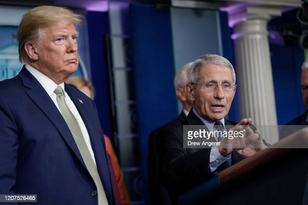US President Donald Trump looks on as National Institute Of Allergy And Infectious Diseases Director Dr Anthony Fauci speaks during a press...
