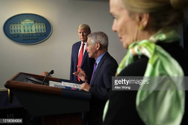 President Donald Trump looks on as National Institute of Allergy and Infectious Diseases Director Anthony Fauci speaks during the daily briefing of...