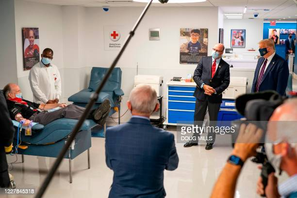 President Donald Trump looks on as patients donate plasma at the American Red Cross National Headquarters in Washington, DC, July 30, 2020.