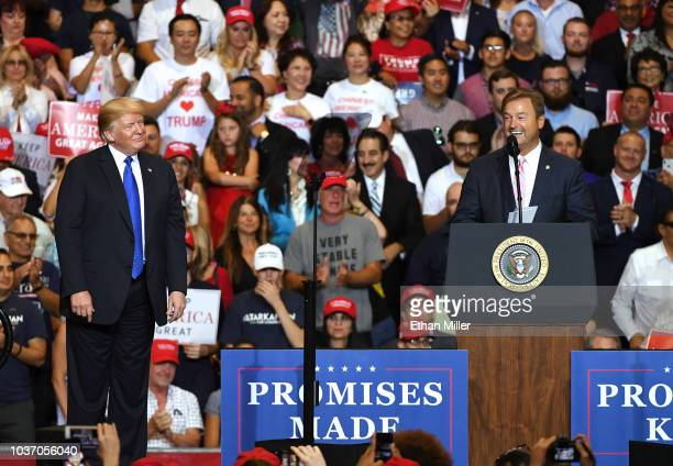 S President Donald Trump looks on as US Sen Dean Heller speaks during a campaign rally at the Las Vegas Convention Center on September 20 2018 in Las...