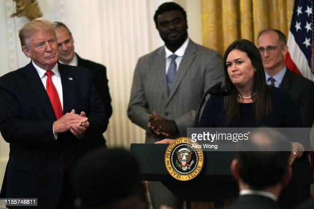 """S President Donald Trump looks on as White House Press Secretary Sarah Sanders pauses during an East Room event on """"second chance hiring"""" June 13..."""