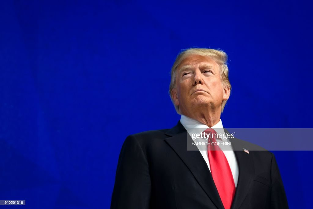 President Donald Trump looks on before delivering a speech during the World Economic Forum (WEF) annual meeting on January 26, 2018 in Davos, eastern Switzerland. / AFP PHOTO / Fabrice COFFRINI