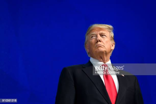 President Donald Trump looks on before delivering a speech during the World Economic Forum annual meeting on January 26, 2018 in Davos, eastern...