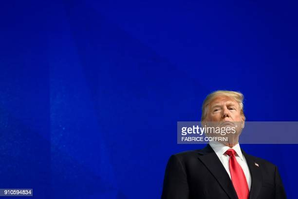US President Donald Trump looks on before delivering a speech during the World Economic Forum annual meeting on January 26 2018 in Davos eastern...