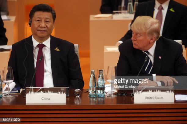 US President Donald Trump looks on Chinese President Xi Jinping during the plenary session at the G20 Summit on July 7 2017 in Hamburg Germany