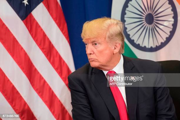 US President Donald Trump looks on during a bilateral meeting with Indian Prime Minister Narendra Modi on the sideline of the 31st Association of...