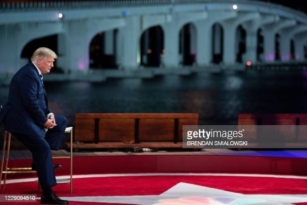 President Donald Trump looks on during a break in an NBC News town hall event at the Perez Art Museum in Miami on October 15, 2020.