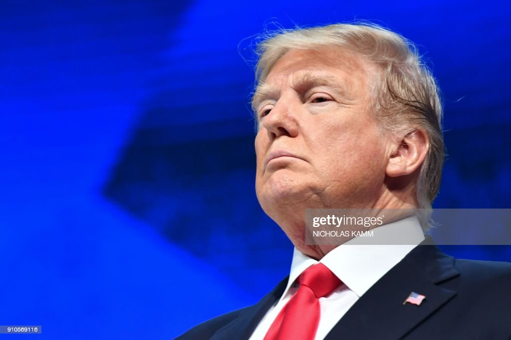 US President Donald Trump looks on during a ceremony before delivering a speech during the World Economic Forum (WEF) annual meeting on January 26, 2018 in Davos, eastern Switzerland. / AFP PHOTO / Nicholas Kamm