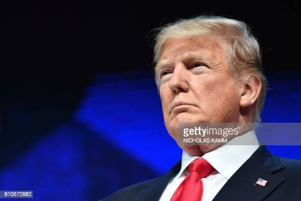 US President Donald Trump looks on during a ceremony before delivering a speech during the World Economic Forum annual meeting on January 26 2018 in...