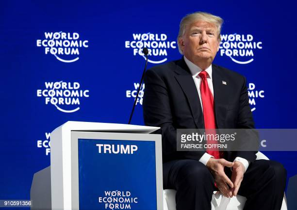 US President Donald Trump looks on during a discussion after delivering his speech during the World Economic Forum annual meeting on January 26 2018...