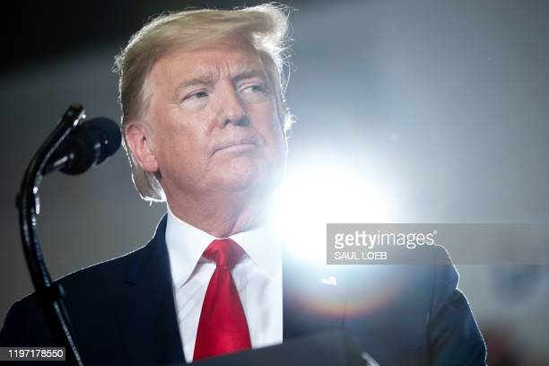 """President Donald Trump looks on during a """"Keep America Great"""" campaign rally at Wildwoods Convention Center in Wildwood, New Jersey, January 28, 2020."""