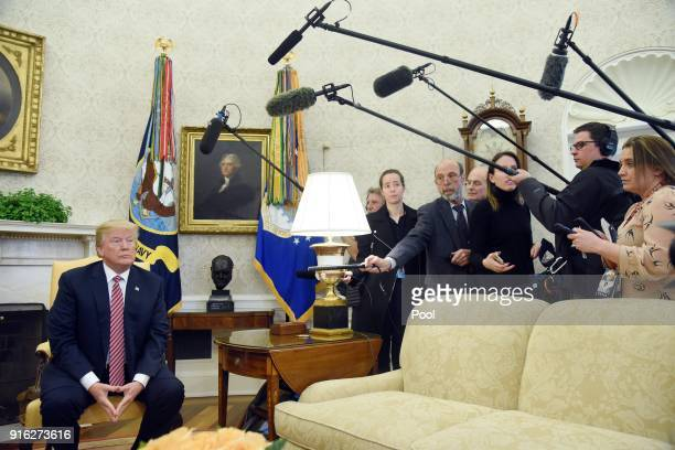 US President Donald Trump looks on during a meeting with Don Bouvet who has been battling cancer in the Oval Office of the White House February 9...