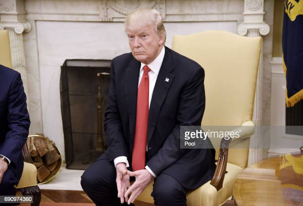 President Donald Trump looks on during a meeting with Prime Minister Nguyen Xuan Phuc of Vietnam in the Oval Office of the White House on May 31 2017...