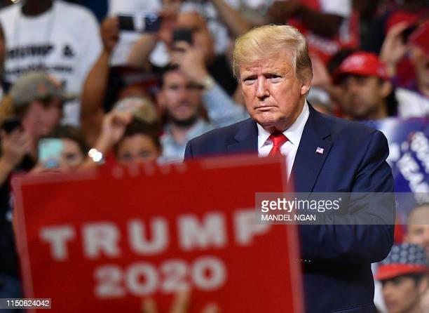 President Donald Trump looks on during a rally at the Amway Center in Orlando Florida to officially launch his 2020 campaign on June 18 2019