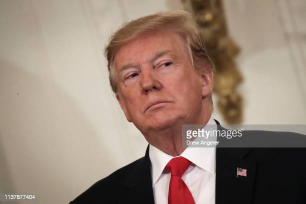 S President Donald Trump looks on during an event recognizing the Wounded Warrior Project Soldier Ride in the East Room of the White House April 18...