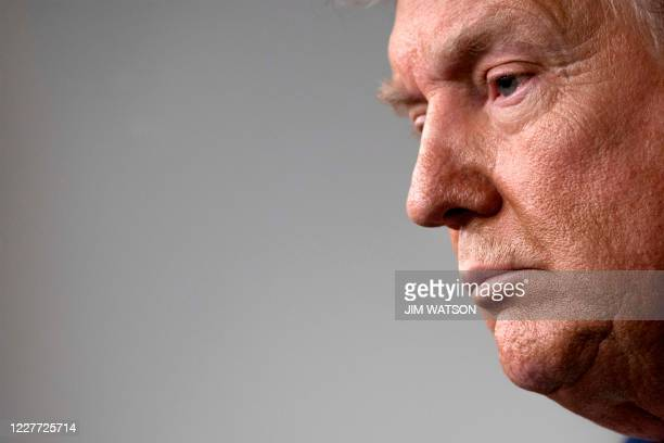 President Donald Trump looks on during the renewed briefing of the Coronavirus Task Force in the Brady Briefing Room of the White House on July 21 in...