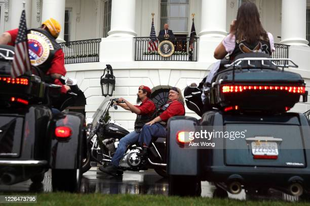 S President Donald Trump looks on from the Truman Balcony as bikers roll pass during a Rolling to Remember Ceremony Honoring Our Nation's Veterans...