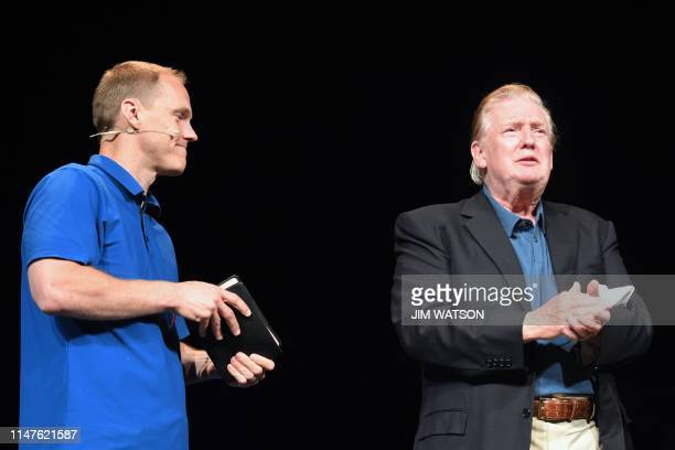 US President Donald Trump looks on next to Pastor David Platt as he visits McLean Bible Church in Vienna Virginia on June 2 to pray for the victims...