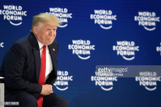 US President Donald Trump looks on prior to deliver a speech at the Congress center during the World Economic Forum annual meeting in Davos on...