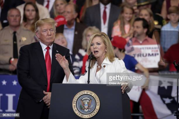 US President Donald Trump looks on Rep Marsha Blackburn who is running for US Senate speaks during a rally at the Nashville Municipal Auditorium May...