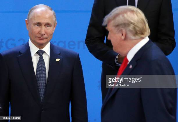 US President Donald Trump looks on Russian President Vladimir Putin during the family photo at the G20 Summit's Plenary Meeting in Buenos Aires...
