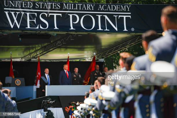 President Donald Trump looks out onto West Point graduating cadets during commencement ceremonies at Plain Parade Field at the United States Military...